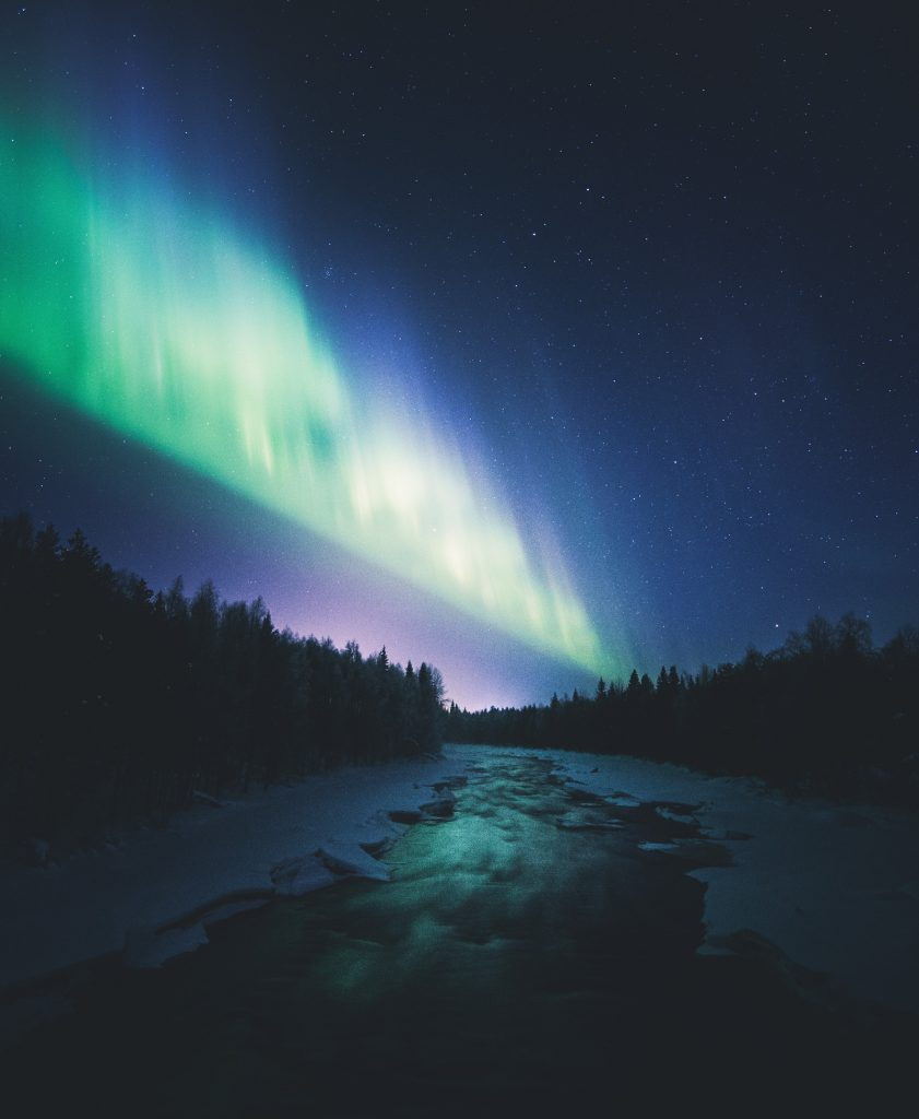 Blazing Northern Lights above a partially thawed river. The Revontuli room is inspired by the magnificent colours of Lapland's Northern Lights.